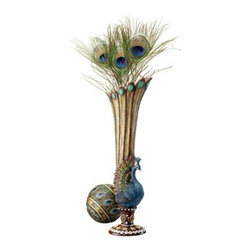 Design Toscano 13.5H in. Peacock Vase - Whether showcasing a single perfect bloom or displaying on its own, the Design Toscano 13.5 in. Peacock Vase catches the eye with its color and style. Cast in designer resin, this bud vase is hand-painted in bold colors with faux metallic accents. About Design ToscanoDesign Toscano is the country's premier source for statues and other historical and antique replicas, which are available through the company's catalog and website. Design Toscano's founders, Michael and Marilyn Stopka, created Design Toscano in 1990. While on a trip to Paris, the Stopkas first saw the marvelous carvings of gargoyles and water spouts at the Notre Dame Cathedral. Inspired by the beauty and mystery of these pieces, they decided to introduce the world of medieval gargoyles to America in 1993. On a later trip to Albi, France, the Stopkas had the pleasure of being exposed to the world of Jacquard tapestries that they added quickly to the growing catalog. Since then, the company's product line has grown to include Egyptian, Medieval and other period pieces that are now among the current favorites of Design Toscano customers, along with an extensive collection of garden fountains, statuary, authentic canvas replicas of oil painting masterpieces, and other antique art reproductions. At Design Toscano, attention to detail is important. Travel directly to the source for all historical replicas ensures brilliant design.