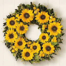 Preserved Sunflower Wreath - Recycling your old fall wreath just won't cut it! Freshen up your entrance with a yellow field of sunflowers, and greet your guests with this dazzling spring sensation. Displaying a new wreath is a great way to transition between seasons and it's such a simple switch.
