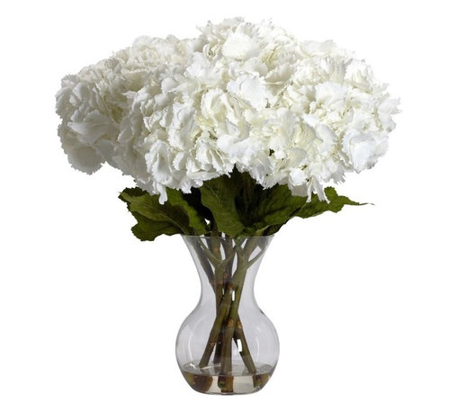 """Large Hydrangea with Vase Silk Flower Arrangement - """"Substantially delicate"""" is the perfect phrase to describe this beautiful faux Hydrangea and vase set. The substantial part comes from stems of this flower - tall, green, and thick, they let you know that this is indeed a plant to be reckoned with. The delicate part comes from the billowy blooms- almost like a fluff of cotton in look. Combined in an attractive vase with liquid illusion, this beautiful Hydrangea will stay """"forever fresh"""", and will brighten your decor for years to come. Height= 23 in x Width= 21 in x Depth= 21 in"""
