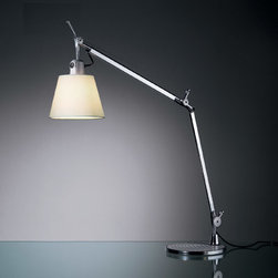Artemide - Tolomeo Shade Table Lamp with Base - Tolomeo with shade table lamp comes with 9 inch table base and features a parchment paper or grey fiber shade with a polished aluminum finish has a fully adjustable, articulated arm and diffuser that remains vertical regardless of the arm angle. Available in floor, table and wall versions with grey fiber or parchment shades. One 75 watt, 120 volt A19 medium base incandescent lamp or 13 watt 120 volt T4 Hex Tube GX24q-1compact fluorescent lamps not included. 7 1/16 inch x 5 5/16 inch diameter shade.  25 5/8 inches deep x 26 inches high x 42.5 inch maximum arm extension.  Directional general light distribution. UL listed.