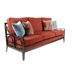 """Coto - Pre-owned Coto Outdoor Sofa in Cranberry - This Coto outdoor """"O Ring """" sofa is a one of a kind find. Wrought iron powder-coat Finish with wood texture hand applied. Upholstered with outdoor Dri-fast foam inserts and loose seat-back cushions with decorative pillows included. Fabric is a plush Sunbrella Chenille Rust Cranberry Color. This beauty can be used indoors or out.  Would be great for a high traffic family room too!"""