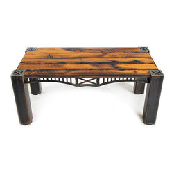 The Nicholson Coffee Table - Inspired by the Nicholson Bridge in Pennsylvania, this proud table supports a top made from reclaimed barn siding salvaged 30 miles from its namesake. An outstanding feature of our Nicholson Coffee Table is a decorative steel band that bridges 4″ tubular legs.  Available in custom sizes and as a dining table.  Steel color shown is Black Veil with Copper accents.  Please call 406-582-0711 for pricing and ordering information, or email us at sales@brandnerdesign.com.
