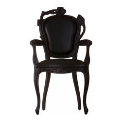 Smoke Dining Armchair - This Smoke chair is a reinterpretation of the classical bergère chair, à la one of the King Louis — but I'm not sure whether the reference is to XIV, XV or XVI. It is super cool, especially in its burnt-fire smoked look. I would love to see a bunch of them around a modern dining room table.