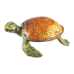 Zeckos - Cute Mosaic Amber Glass Sea Turtle Accent Lamp - This beautiful amber stained glass sea turtle shaped lamp adds the perfect accent to desks or nightstands of turtle lovers. Measuring 3 1/6 inches tall, 8 inches long and 6 inches wide, the lamp features an antiqued bronze finished resin base of the turtle`s head, legs and tail, with the shell made of tiny bits of amber glass. The lamp is brand new, never used or displayed. It uses one nightlight style bulb (included). It makes a great gift idea. We have a very limited supply of these, so don`t delay. Get yours now!