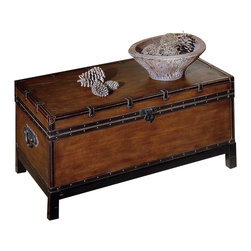Steve Silver - Steve Silver Voyage 44x24 Storage Cocktail Table in Antique Cherry - Create a classic style with the brown Voyage trunk, cocktail, and end tables. This gorgeous coffee table has a rectangle shape and features a trunk style. With square legs this trunk has leather like finish in a rectangle shape and nail head trim around the bottom and the opening with a metal flap lock. The top is smooth with decorative leather like trim with straps and metal pulls on the sides. This Voyage dark brown coffee and end table will bring decorative charm to any home decor. What's included: Cocktail Table (1).