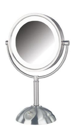 Jerdon HL8808NL 8.5-Inch Tabletop LED Vanity Mirror with 8x Magnification - The Jerdon HL8808NL 8.5-Inch Tabletop Two-Sided Swivel LED Lighted Vanity Mirror is an ideal bathroom and makeup accessory that provides lighting and magnification options to display a clean, bright reflection whenever you need it. This two-sided circular mirror has an 8.5-inch diameter and features a smooth swivel design that provides 1x and 8x magnification options to make sure every detail of your hair and makeup are in place. The halo light design around the perimeter of the mirror and smooth rotation provide a dynamic point of view with (3) LED light settings to make sure the lighting is right. An on/off rotary knob on the base will activate the lighting whenever you need it. The HL8808NL stands 16-inches high, stands upright on countertops, vanities and tables and has an attractive nickel finish that protects against moisture and condensation. The Jerdon HL8808NL 8.5-Inch Tabletop Two-Sided Swivel LED Lighted Vanity Mirror comes with a 1-year limited warranty that protects against any defects due to faulty material or workmanship. The Jerdon Style company has earned a reputation for excellence in the beauty industry with its broad range of quality cosmetic mirrors (including vanity, lighted and wall mount mirrors), hair dryers and other styling appliances. Since 1977, the Jerdon brand has been a leading provider to the finest homes, hotels, resorts, cruise ships and spas worldwide. The company continues to build its position in the market by both improving its existing line with the latest technology, developing new products and expanding its offerings to meet the growing needs of its customers.