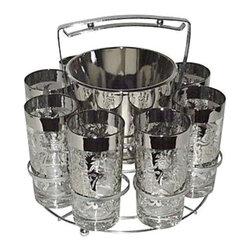 "Pre-owned Silver Mid-Century Glasses with Caddy - This stylish caddy features a set of 8 silver and clear drinking glasses with an ice bucket.  The set is in excellent condition with little-to-no signs of wear. Festive barware for any home!    The glasses measure 6"" H x 3"" D x 3"" L.    The ice bucket measures 5"" H x 6"" D"" x 6"" L.   The caddy measures 12"" H x 11""D x 11"" L."