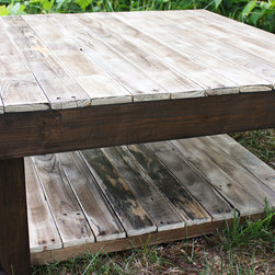 The Shades of Grey Reclaimed Pallet Wood Coffee Table - The Shades of Grey is a rustic and beautiful table with rich tones of browns and greys highlighting all of the natural scruffs and scrapes of the wood. The top of the table has a clear coat of water-based poly which brings out the character - and keeps it spill resistant! The frame of the table is stained in dark Kona and has an added shelf for storage that is perfect for baskets or bins.
