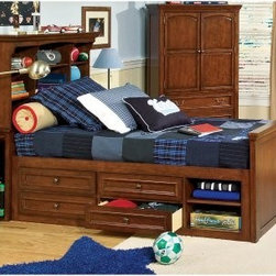 American Spirit Bookcase Captains Bed Collection - Your little bookworm's going to love keeping books handy with the American Spirit Bookcase Bed. Crafted from select poplar solids and cherry veneers this bed sports a warm medium brown cherry finish. Reinforced and rounded corners ensure sturdiness and kid-grade durability.This beautiful bed features a bookcase headboard that offers space-efficient storage and creates a cozy feel. Five adjustable shelves and an open storage area underneath are perfect for keeping favorite books photos alarm clocks and other bedside necessities handy. A pull-out tray offers a useful place to rest a drink or snacks. Plus you can add on the matching chest and nightstand all crafted with the same high quality and rich finish. Features of optional nightstand:1 dovetail drawer; 1 stationary shelfFramed ends and framed drawersReinforced and rounded corners and solid wood corner blocksWheel-assisted metal drawer guides with drawer stopsStylish bun feetAntique bronze hardwareMeasures 23W x 16D x 25H inchesFeatures of optional chest:5 dovetail drawers; top 2 drawers are felt-linedFramed ends and framed drawersReinforced and rounded corners and solid wood corner blocksWheel-assisted metal drawer guides with drawer stopsStylish bun feetAntique bronze hardwareSafety anchors included for added safetyMeasures 40W x 18D x 51H inches Dual bed-rail locking positions allow you to lower the height for toddlers or raise it to accommodate under-bed storage. The bed includes a pair of bed rails that bolt on firmly with heavy-duty steel connectors. This bed is available with an optional captain's or trundle storage unit. The captain's storage option (pictured) provides ample storage with two layers of drawers and shelves. The trundle option provides a space for an extra guest bed or blanket and toy storage. Twin Bed Dimensions:Complete bed: 95L x 46W x 56H inchesHeadboard: 46W x 16D x 56H inchesFootboard: 46W x 3D x 30H inchesFull Bed Dimensions:Complete bed: 95L x 60W x 56H inchesHeadboard: 60W x 16D x 56H inchesFootboard: 59W x 3D x 30H inchesStorage Dimensions:Trundle: 75L x 41W x 13H inchesCaptain's storage unit: 76L x 20W x 20H inchesAbout Legacy Classic FurnitureCommitted to offering the best of today's youth-bedroom styles for the young and young at heart Legacy Classic Furniture offers a wide selection of best selling designs and finishes with a large variety of beds and storage and study options. Dedicated to providing outstanding quality at reasonable prices Legacy Classic Furniture employs quality materials proven construction techniques and the highest safety standards to manufacture exceptional products that are built to last a lifetime.