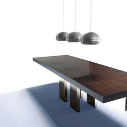 Dining Tables - Modern collection of dining room tables, glass extension tables, kitchen tables and chairs available in numerous finishes, sizes, exotic woods, marbles, stones, lacquers and glass. Available at Theodores.com