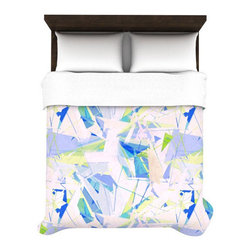 Shattered Sky Woven Duvet Cover - Add a brilliant splash of color to your bed. Inspired by the look of shattered glass, this duvet cover will provide an eye-catching accent for your bedroom. Crafted out of polyester on top with a cotton/poly blend on the bottom, the colors won't fade for a long-lasting touch.