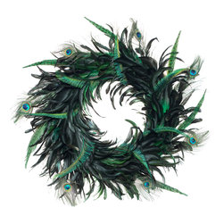 Peacock Wreath - This is so chic and unexpected. I would love to use a pair of these on my French doors or see them sitting on a dining room buffet.