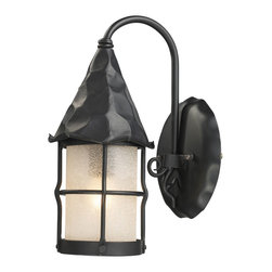 Elk Lighting - EL-381-BK Rustica 1-Light Outdoor Sconce in Matte Black and Amber Scavo Glass - Bring storybook flair to an old english, cottage or spanish revival-style home with the Rustica Collection. Hand-hammered iron and scavo seedy-glass cylinders characterize this series, which may be ordered in matte black (bk) with white scavo glass and antique copper (ac) with amber scavo glass. They may be used in both indoor and outdoor locations. (ul listed).