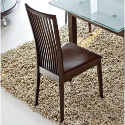 Calligaris - Calligaris Philadelphia Leather Dining Chair - Set of 2 - CD235 - Shop for Dining Chairs from Hayneedle.com! Lingering at the table over a leisurely meal is sure to become a perpetual guilty pleasure when you have Calligaris Philadelphia Leather Dining Chair - Set of 2 gracing your dining area. Boasting subtle curves comfortable seat and a tall slatted backrest this set of two dining chairs combines clean lines and a contemporary design to create the perfect seating options for modern homes. When it comes to durability you won't have a thing to worry about either thanks to the sturdy beechwood construction in Glossy Mahogany or Glossy White finishes. Choose from a selection of leather seat colors to complement your existing decor.About Calligaris FurnitureThis item is manufactured by the Calligaris company. Begun in 1923 in Italy Calligaris Furniture has steadily grown to become a leader in the furniture industry. Their designs are renowned throughout the world for sleek contemporary form and function. Calligaris items exceed industry standards and the company proudly complies to environmental standards regarding forestry and sustainable resources. The name Calligaris is synonymous with exciting design high quality and forward thinking.