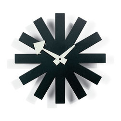 Vitra - Nelson Asterisk Clock - DesignThe Asterisk Clock (1950) is one of more than 150 clocks designed by George Nelson Associates for the Howard Miller Clock Company, which sold them from 1949 into the 1980s. Nelson Associates, first launched as a studio by George Nelson in 1947 in New York City, employed some of the most celebrated designers of the time, including Irving Harper, Don Ervin and Charles Pollock, all of whom contributed to the clocks. Until its closure in the mid-1980s, the company designed a range of products for many clients, including Herman Miller, Inc., which was established in 1923 by Howard Miller's brother-in-law, D.J. De Pree. A bit of family history: De Pree also founded the Herman Miller Clock Company in 1926 but turned it over in 1937 to Howard, who renamed it. As for the identity of Herman Miller, he was Howard's father and De Pree's father-in-law. The Miller companies are not affiliated but stand across the street from one another in Zeeland, Mich. The Asterisk Clock appeared in the original Miller brochure as Model 2213. This is an authentic Nelson Clock, produced by Vitra Design Museum. Uses one AA battery (included). Made in Poland.