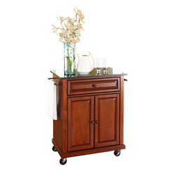 Crosley Furniture - Crosley Furniture Black Granite Top Classic Cherry Kitchen Cart - Crosley Furniture - Kitchen Carts - KF30024ECH - Constructed of solid hardwood and wood veneers this portable kitchen cart is designed for longevity. The beautiful raised panel doors and drawer front provide the ultimate in style to dress up your kitchen. The deep drawer is great for anything from utensils to storage containers. Behind the two doors you will find an adjustable shelf and an abundance of storage space for things that you prefer to be out of sight. The heavy duty casters provide the ultimate in mobility. When the cabinet is where you want it simply engage the locking casters to prevent movement. Style function and quality make this portable kitchen cart a wise addition to your home.