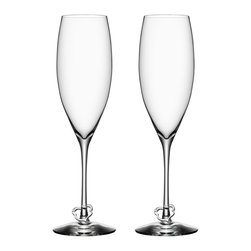 Orrefors - Crazy Heart Flutes, Set of 2 - Madly in love! Efva Attling's new crazy heart consists of a pair of champagne glasses for newlyweds, people who are newly engaged or newly in love or those who simply want to celebrate love. The glasses are softly rounded and the bowl ends in a deep point that makes the champagne bubbles rise slowly in the glass. A toast to love!