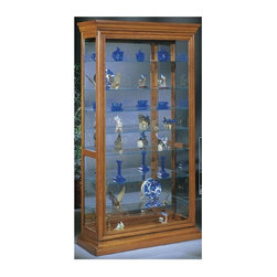 Philip Reinisch - Philip Reinisch Lighthouse Manifestation - Tr - You get a great view from any angle when you display your collectibles in this deluxe Manifestation curio cabinet from the Philip Reinisch Lighthouse Collection. The large glass front door slides open smoothly in either direction for easy access. A spacious lighted interior features glass shelves that are adjustable in height to hold items of assorted sizes. Masterfully crafted from solid oak, this simple yet elegant design is the perfect way to highlight your treasures in style. Plated glass mirror back. Eight adjustable shelves. Lighted (U.L. and C.S.A Approved): uses (1) 50 watt bulb. Elegantly shaped picture frame front. Hand-rubbed and polished. Made from Solid Northern White Oak. Cabinet door slides just under half way to both sides. Opening width of the cabinet is 44 inches to the widest point which includes the molding around the base. 44 in. W x 17 in. L x 80 in. H (175 lbs.)