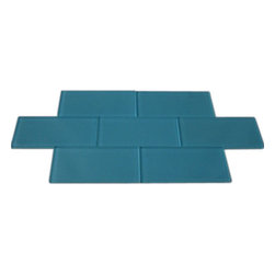 "Loft Turquoise Polished Glass Tiles - Loft Turquoise Polished 3""x6"" Subway Glass Tile This turquoise subway tiles are decorative and durable, making it a great back drop. The glass tile will reflect the light in your room, giving it a fresh, clean and brighter look. Using a subway tile as a back splash you will add some color and style to your kitchen decor or any decorated room in your home. It will also give it a more distinct look. Chip Size: 3""x6"" Color: Turquoise Material: Glass Finish: Polished Sold by the Square Foot - 8 pieces per square foot Thickness: 8mm Please note each lot will vary from the next."