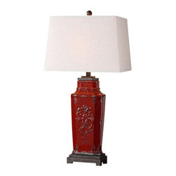 Uttermost Centralia Red Lamp - Embossed ceramic finished in a deep red glaze with aged black undertones and rust brown accents. Embossed ceramic finished in a deep red glass with aged black undertones and rust brown accents. The rectangle, tapered hardback shade is an oatmeal linen fabric with light slubbing.