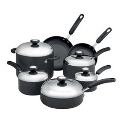 Circulon Total 12 pc. Cookware Set - Dark Gray - Invite your friends over for some delicious Tex-Mex dishes with a healthy twist made using the Circulon Total 12 pc. Cookware Set - Dark Gray. Simmer a flavorful tortilla lime soup in the stockpot, while black beans finish in the saucepan. Sizzle marinated skirt steak in one skillet and onions and green peppers in the other for fajitas. Round out the spicy feast by preparing Mexican brown rice in the covered saute pan. Featuring the TOTAL Food Release System, this set is made using DuPont's Autograph three-layer nonstick coating on raised circles which reduces surface abrasion, helps your pans to last for years, and delivers extraordinary food release and exceptional dependability. The set's heavy gauge hard-anodized construction provides even heating to help reduce hot spots that could burn food and ruin a meal. Durable stainless steel lids form a tight seal to trap flavor, heat, and moisture. Each piece features comfortable, phenolic handles that are oven safe to 350 degrees. With everything included that you need to start making delicious homemade meals, this set will help you get your family to the table for meals for years to come. Additional Features Features the TOTAL Food Release System DuPont's Autograph 3-layer nonstick coating Raised circles reduce surface abrasion Circles also help with food release Hard anodized construction for even heating Reduces hot spots that can burn food Safe for use with metal utensils Easy to clean and dishwasher safe Durable stainless steel lids form a tight seal Lids lock in heat and moisture Set Includes:1-Quart Covered Saucepan 2-Quart Covered Saucepan 3-Quart Covered Saucepan 8-Quart Covered Stockpot 8-Inch Open Skillet 10-Inch Open Skillet 3-Quart Covered Saute PanAbout CirculonCirculon's gourmet nonstick cookware is engineered to make home cooking fast, easy, healthy, and delicious. In 1985, Circulon revolutionized the industry by introducing the first hard-anodized nonstick cookware. Their patented TOTAL Food Release System creates Circulon's signature circular groove pattern on the cooking surface, which reduces the amount of nonstick that comes into contact with cooking utensils for reduced abrasion and superior durability. Combined with the most advanced nonstick coating from DuPont, this innovative technology is also dishwasher-safe and induction-suitable. New cooks and seasoned chefs alike will be satisfied with Circulon cookware for a lifetime - guaranteed.