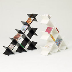 Pyramid Bookshelf - This bookshelf is anything but boring, and yet it's totally functional. The design is great, and the functionality is perfect.