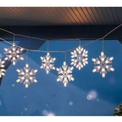 9 Clear Snowflake Icicle String Lights - Instead of wrapping string lights around my front porch, I like the idea of hanging these from the ceiling. They would make the entrance to the house so pretty!