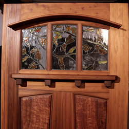 The Entradero House Entry Door - Zoleta Lee Designs Zoleta Lee Designs Autumn Leaf Stained Glass Window in The Entradero House Entry Door.  Made of solid vertical grain Old Growth Redwood.  It has birds-eye burl panels with a Redwood Dentil shelf