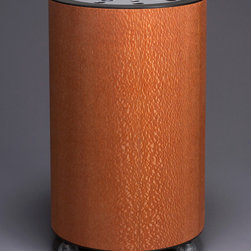 """Launch"" Clothing Hamper   (Lacewood) - Cylindrical wood enclosure with exotic  veneer,perforated, brushed aluminum lid opens 155 degrees for ease of accessibility to the removable catch bag. Mounted on casters for mobility. Available in 16"" or 18"" diameters."