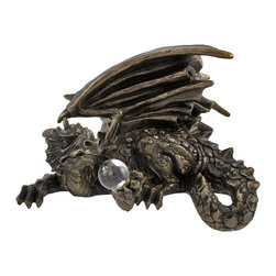 Zeckos - Bronzed Dragon with Crystal Ball Computer Topper/Shelf Edge Statue - Add a unique accent to mantels, bookshelves, monitors, entertainment centers, desks and more with this dragon sculpture. Made of cold cast resin, it measures 5 3/4 inches long, 4 inches tall, and 3 inches wide with the arm, claws, and loop of the tail hanging over the edge of wherever it is displayed. This piece has a bronzed finish, and is incredibly detailed from the striations in the dragon's wings to the texture of its scales. It is a great addition to fantasy art collections, and is sure to start a conversation. NOTE: Double sided tape is included to secure the dragon to its new resting place.