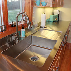 Stacia's one-piece, custom kitchen stainless steel sink and counter top — Retro