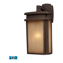 Elk Lighting - EL-42141/1-LED Sedona LED 1-Light Outdoor Sconce in Clay Bronze - Simplicity of craft and form gives the Sedona Collection a very attractive look through its minimalist approach. Inspired by the architecture and casual lifestyle of the desert southwest, this collection features clean lines with recessed edges, caramel beige glass, and a clay bronze finish. - LED offering up to 800 lumens (60 watt equivalent) with full range dimming. Includes an easily replaceable LED bulb (120V).