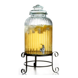"""Jay Companies - Ribbed Glass Cylinder Beverage Dispenser on Rack - Treat your house guests to en elegant night of home entertaining with our stunning cylinder glass beverage dispenser. Perfect for gatherings that call for plentiful servings, this cylinder glass beverage server is sure to add a dash of class and convenience to any soiree! The metal stand conveniently elevates jar for an attractive presentation and easy dispensing indoors or out. Featuring a wide opening for effortless refilling and cleaning, and a heavy duty acrylic spigot for a smooth and efficient flow.    * Capacity: 3 gallons  * Dimensions: H: 21"""""""