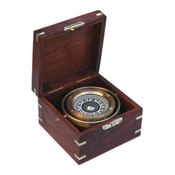 Small Brass Gimbaled Modern Sailboat Compass w/ Hardwood Case - This item is a modern, accurate and fully functional sailboat compass.  This boxed compass is also gimbaled so that the compass remains level even if placed in a boat that severely heels.  The brass on the compass is lacquered so it will not tarnish.  The liquid-damped compass is 4 inches (10.2 cm) in diameter, the compass card is 2 7/8 inches (7.3 cm) in diameter, and the case measures 6 1/4 inches (15.9 cm) square and 4 3/16 inches (10.7 cm) tall. This item weighs 3 pounds, 12 ounces (1.7 kg).