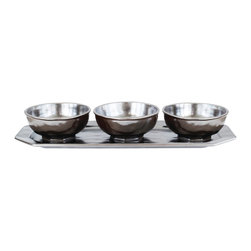 Pewter Stoneware Hostess Set - Three gleaming bowls set atop an equally lustrous tray create a most distinctive presentation for your celebratory soiree or holiday fete. Perfectly sized and timeless in design, the Pewter Stoneware 4 Piece Hostess Set allows for stylish serving of assorted nibbles, condiments, or candies. A handsome addition to your dinnerware collection, this set blends effortlessly with your transitional tablescape.