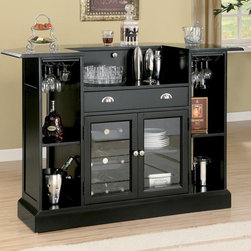 Bar Table Unit - A contemporary bar with a serving area in the shape of half an octagon. Bar features wine bottle holders and shelving with a hanging stemware rack above.