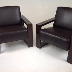 Milo - Modern lounge chairs.  Finish is a custom safari.   Fabric is a faux leather.   Modernism
