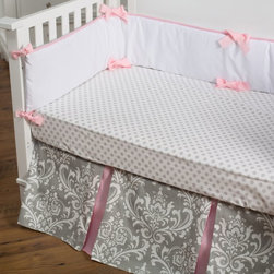New Arrivals - New Arrivals Stella Crib Bedding Set - Gray Multicolor - CRIB2-SG - Shop for Bedding Sets from Hayneedle.com! Add style and sophistication to your little girl's crib with the New Arrivals Stella Crib Bedding Set Gray. Made of soft 100% cotton this two-piece bedding set includes a crib skirt and cozy crib sheet. Featuring an elegant damask pattern in gray with soft pink detail this bedding set is perfect for any little girl! Each piece in this set is to be cleaned by machine-washing on cold. Complete this crib bedding collection by adding the matching blanket and bumper (both optional). The bumper is dry clean only.About New Arrivals Inc.New Arrivals Inc. was started 15 years ago by mom-of-three Tori Swaim. What started as a small accessory and gift product line has grown into hundreds of products including bedding nursery and kids room decor letters and baby gifts. New Arrivals Inc. is your one-stop-shop for designing the baby nursery or kids room of your dreams.