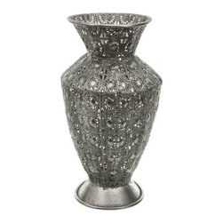 Wrought Iron Fluted Flower Vase - Interior designer-approved, the Wrought Iron Fluted Flower Vase has that exotic touch your room needs. Ornately embossed with a handsome silver finish, this lightweight iron vase shines. Cut-out details make it a fetching centerpiece alone or when filled with your favorite dried arrangements. This vase is built durably enough to decorate your indoor or outdoor living space. About Oriental FurnitureOriental Furniture is based in Massachusetts and began as a retail store in 1985. Since then they have grown to become a leading importer of a wide range of Asian furniture, accents, and decorative accessories. They strive to find exotic, well-crafted pieces for eclectic interior designers and creative home decorators. Some of their products include simple Zen style Japanese furniture, futons, tatami mats, rattan, and heirloom-quality pieces. Classical hand-painted Chinese decor items include fine wood grain and lacquered furniture, oriental lamps, porcelain pieces, and serene wall art. Oriental Furniture also has a vast array of room dividers and floor screens. Their selection includes classic Japanese shoji screens and sliding doors, hand-painted Chinese screens, and eco-friendly bamboo and rattan floor screens.