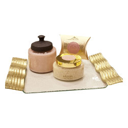 """Ayurveda Bath Candle w/ Gold Leaf Wave Tray - Give them something unique like this gorgeous artisan vanity tray featuring gold leaf wave handles that will look great beside a gold plated faucet. This unique candle gift comes with a double-wicked candle, paired with beautifully scented bath salts and soap by Everybody's Ayurveda, all placed on a very stylish glass tray. The whole set has such a luxurious look and feel; the upscale style that you won't find in your Big Box Stores. The effervescent glass jar is 2 wick pink candle that can still be used long after the candle is gone. The glass jar is mouth blown """"lustre"""" iridescent glass and produced by true artisans. To achieve this lustre finish metal oxide is placed in a container while the glass is firing in the kiln, the gas vapors from the metal oxide create the iridescent tint. Variations are to be expected and add to its unique beauty."""