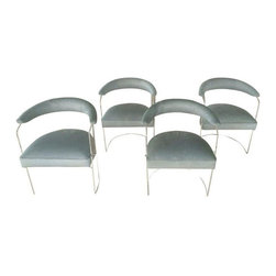 Pre-owned Mid-century Modern Lucite Chairs - Set of 4 - This set of four lucite floating chairs is truly dreamy. The Mid-century Modern chairs are in new condition, and covered in mint-dyed cow hide. Imagine how elegant they'll look in your MCM or Modern dining space.    The top height of the seat is 14.25‰Űť  Floor to the bottom of the cushion is 12.25‰Űť