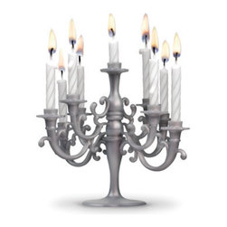 Cake Candelabra - Now here's something that really takes the cake  a show stopping, jaw droppping, birthday cake topping. Nine finely-turned candles fit perfectly into the silver-toned base, creating a stunning centerpiece to your cake. You deserve the finer things in life, so celebrate in style!