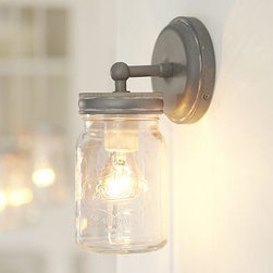 "Exeter Sconce, Set of 2, Galvanized Metal finish - Crafted in the shape of an authentic canning jar and finished with an antiqued base, this sconce brings a bit of country charm to any space. 5"" wide x 5"" deep x 9.75"" high Crafted of glass and aluminum with a hand-applied finish in Distressed Aluminum. Glass canning jar twists off for bulb changes. UL-listed. Hardwire; professional installation recommended."