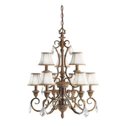 Kichler 9-Light Mid. Chandelier - Ravenna - Nine Light Chandelier. If you enjoy elaborate, detailed lighting with a distinctively european flavor, the Ravenna collection is what you have been looking for. All fixtures are made from hand-wrought steel and hand painted with our exclusive Ravenna finish ensuring a quality look in any room in your home. With gold leaf accents, eggshell fabric shades, and antique satin-etched glass you can be sure that each piece in the Ravenna collection is a work of art. For the homeowner who wants the classic touch of the Ravenna style but doesn't have the space for a larger chandelier, this Chandelier is a wonderful alternative. Featuring a crystal clear trim, this 9 light, 2-tiered Ravenna chandelier has all you're looking for in a compact 24 diameter, 29.5 high package.