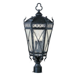 Maxim Lighting - Maxim Lighting Canterbury Forged Iron Traditional Outdoor Post Lantern Light - Tudor style and subtle gothic revival nuances create this visually appealing Maxim Lighting outdoor post lantern light. From the Canterbury Collection, the tapered frame features several ���x' motifs that compliment the elegant leafy accents. Candelabra lights are housed within the forged iron structure and sit proudly behind the seedy glass panels.