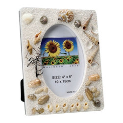 """Shell Picture Frame - The shell picture frame measures 4"""" x 6"""". It features many different sea shells throughout the frame. It will add a definite nautical touch to whatever room it is placed in and is a must have for those who appreciate high quality nautical decor. It makes a great gift, impressive decoration  will be admired by all those who love the sea."""
