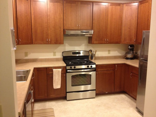 Laminate flooring cabinets before after laminate flooring for Flooring before cabinets