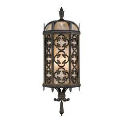 Fine Art Lamps - Costa del Sol Outdoor Coupe, 329681ST - Inspired by the rich design traditions of the historic Mediterranean coast, this sconce lantern evokes old-world elegance with stylized wrought iron quatrefoil designs in an antique patina finish. The textured, tinted glass gives the light a soft, inviting atmospheric warmth.
