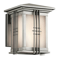 Kichler 1-Light Outdoor Fixture - Stainless Steel Exterior - One Light Outdoor Fixture. The stainless steel finish compliments the unique blend of Asian and mission inspired lines for a stylish look. From the Portman square collection, this lighting outdoor wall sconce also features an etched seedy glass shade that completes the look. Energy efficient compact fluorescent lamp may be used: not included. Height from center outlet: 4""