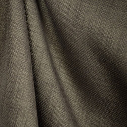 """Colonial Cinder Solid Grey Upholstery Drapery Fabric - Regal fabrics Colonial Cinder is a solid grey upholstery fabric. 100% polyester face with a backing for added strength.  Great for recovering furniture, making throw pillows or covering dining room chair seats.  The Colonial is pliable and soft enough to use as window treatments as well.  Make drapery panels, window valances or cover cornice boards.  57"""" wide with some texture and slight design to give this sold fabric some extra interest. Great when paired with florals or geometrics such as stripes, checks and plaid fabrics."""